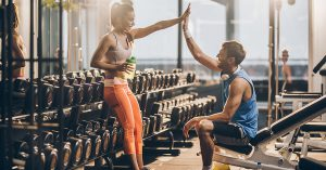 People high-fiving after a workout