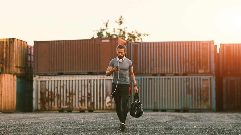 man going to the gym with his gym bag in hand