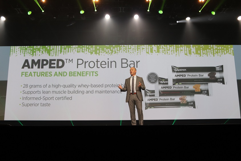 Jim Coover, Isagenix Co-Founder and Chief Executive Officer, launches new AMPED Protein Bars onstage at Celebration 2017.