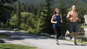 Man and woman running outdoors