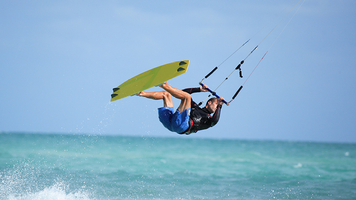 Guy Kitesurfing with a lift in the air
