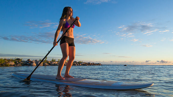 Girl Paddelboarding in the Ocean