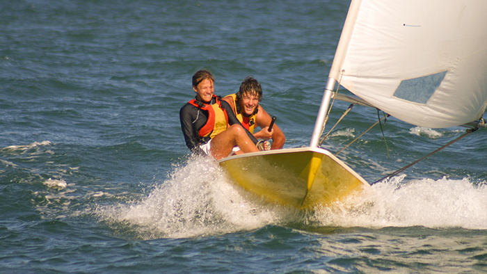 Two people sailing against the wind