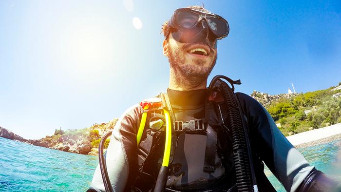 Guy going scuba diving