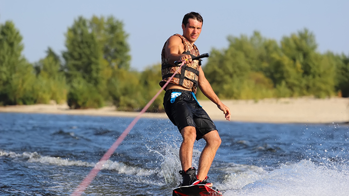 Guy wakeboarding on water
