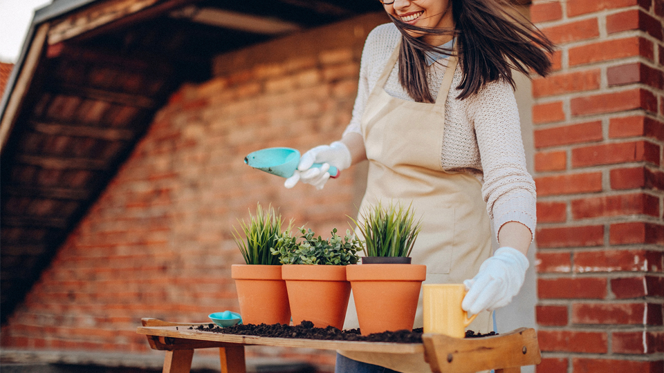 Woman enjoys planting with her compost soil.