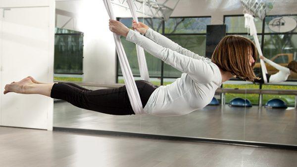 woman in aerial yoga swing