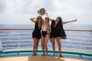 Three friends enjoying a summer cruise