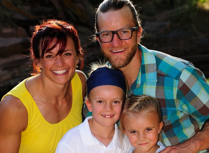 Kayla Johnson with her husband and two daughters.