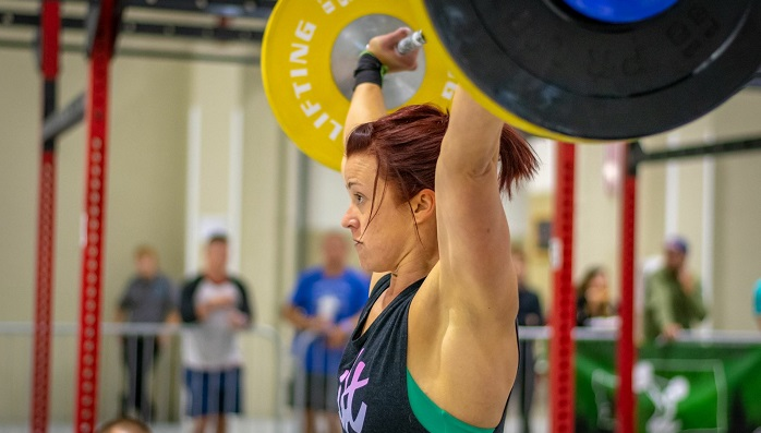 Kayla Johnson powerlifting at a competition.