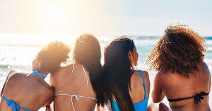Girls sitting on beach