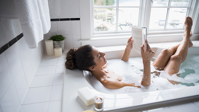 Woman reading in the bathtub