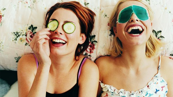 Two girls laughing, enjoying an at-home spa day