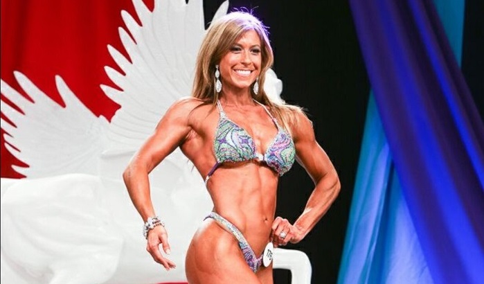 Christie Nix in a bikini posing onstage for a competition.