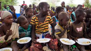 A group of people enjoy a meal together