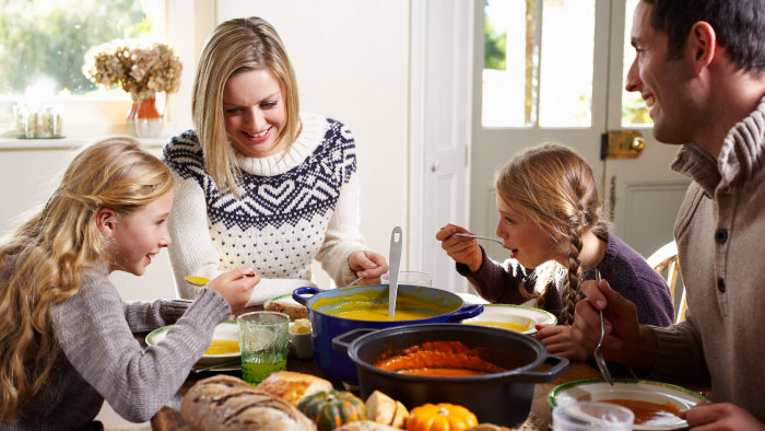 A family enjoysfall foods together at the dinner table