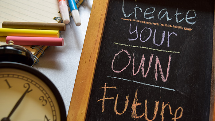 "A chalkboard that says ""Create your own future"""