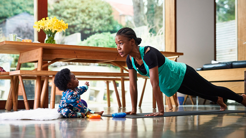 woman in plank with toddler: work/life balance