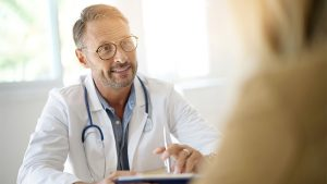 Doctor talking to patient over table