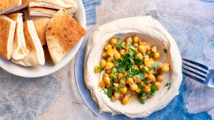 Chickpeas and bread served on a table