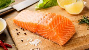 Fresh fish on a wooden cutting board