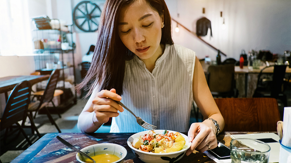 A woman enjoying a healthy meal