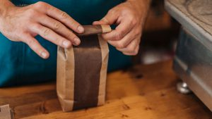 Someone holding a bag of organic coffee
