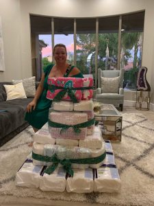 Rachel Thomas smiling behind diaper bags
