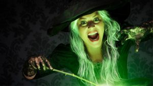 A witch holding a wand with a green glow
