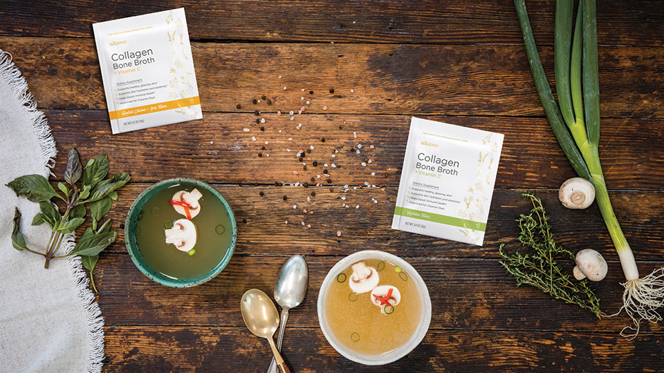 Collagen Bone Broth in bowls on a wood background