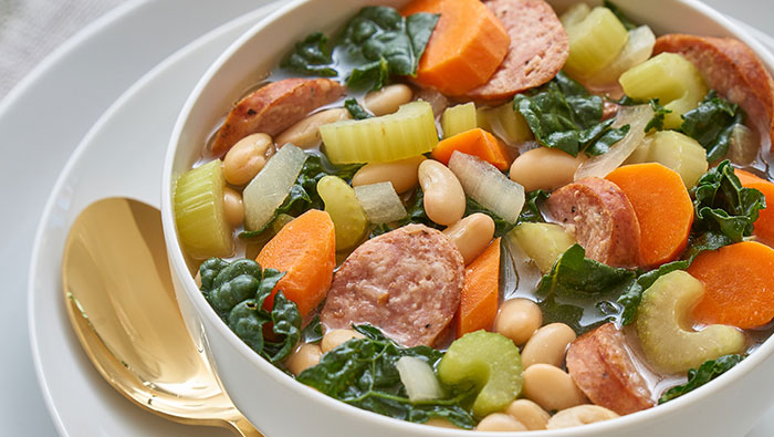 Bowl of kale and sausage soup