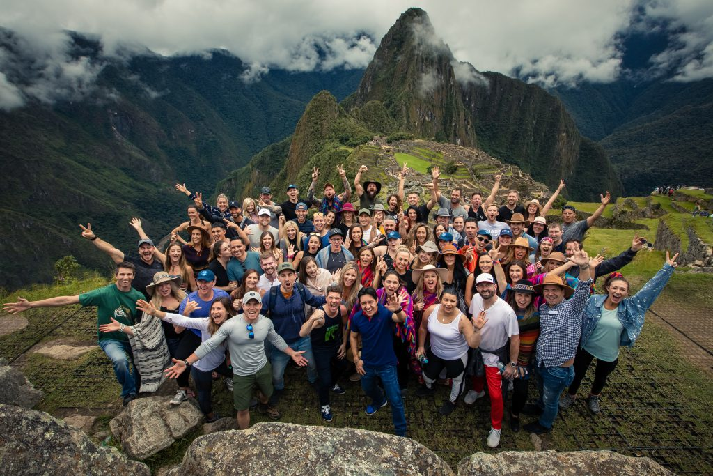Group of people smiling in Machu Picchu