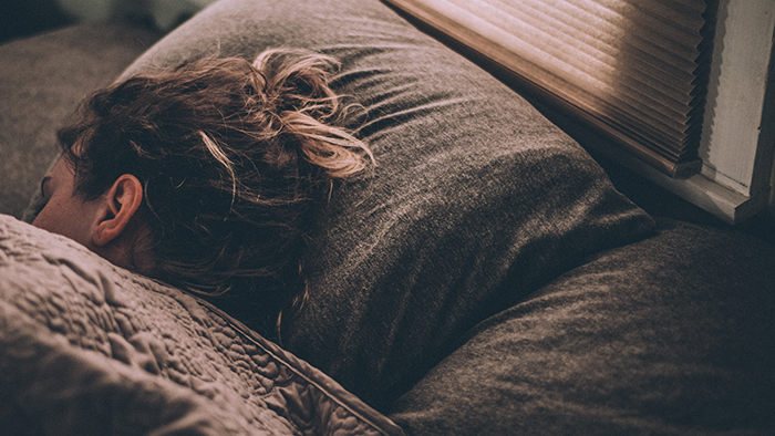 woman sleeps in bed