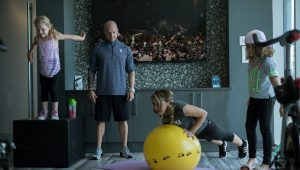 Rod Redzanic and his wife working out with their children at home