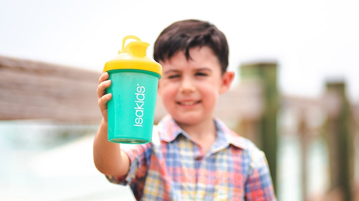 Young boy holding IsaKids shaker bottle