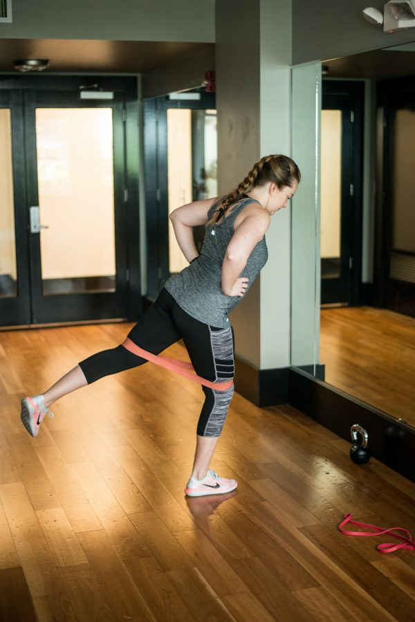 Woman using resistance bands to work out her legs