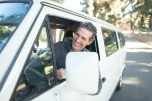 Man leaning out of van window