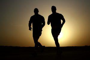 Men running in sunset