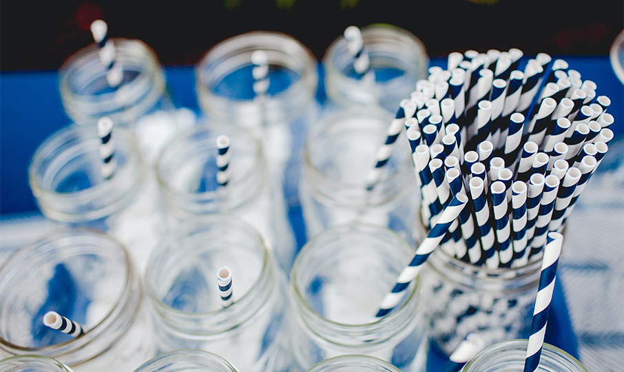 paper straws and water glasses