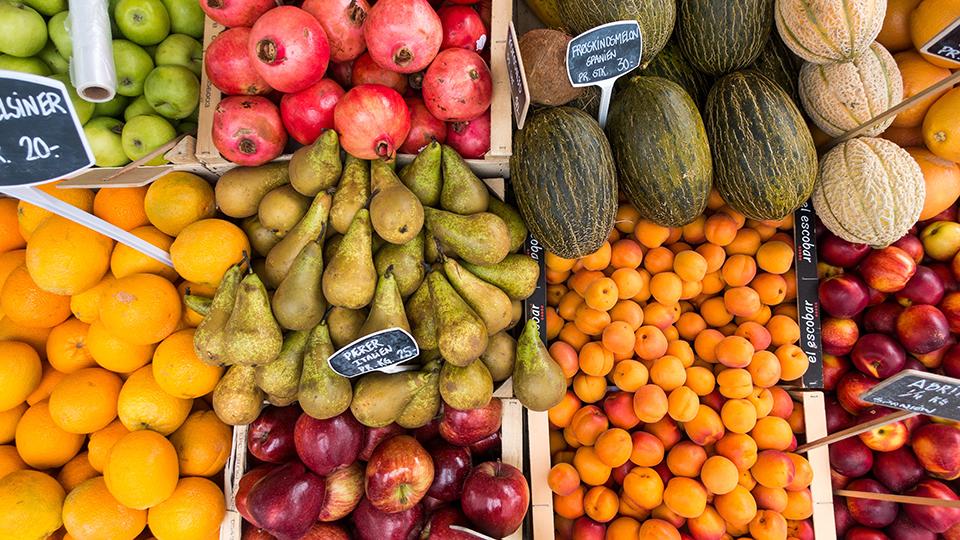 Fresh produce in grocery store bins