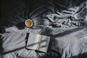 Lazy Day - Book and Coffee on Bed
