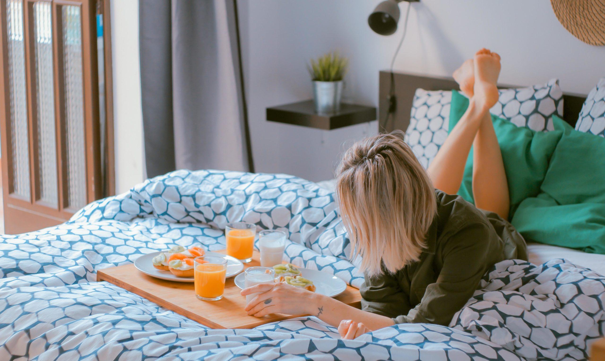 Lazy Day - Girl Having Breakfast in Bed
