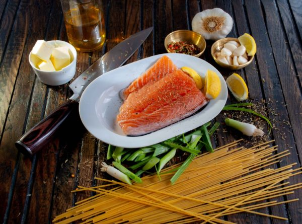 Protein bowl ingredients with salmon and dry pasta