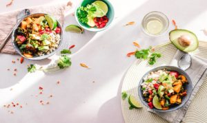 Two healthy protein bowls on a white table