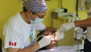 Man providing dental care to patient