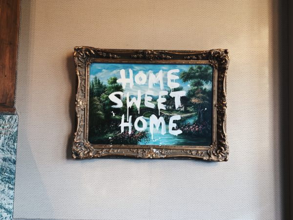 """Home Sweet Home"" painting on a wall"