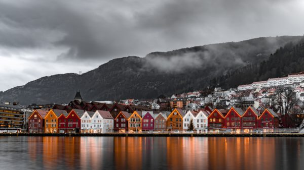 Red, orange, and white Swedish homes on the water