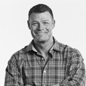 Black-and-white headshot of Alvie Shepherd