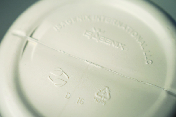 The bottom of an Isagenix PCR plastic canister