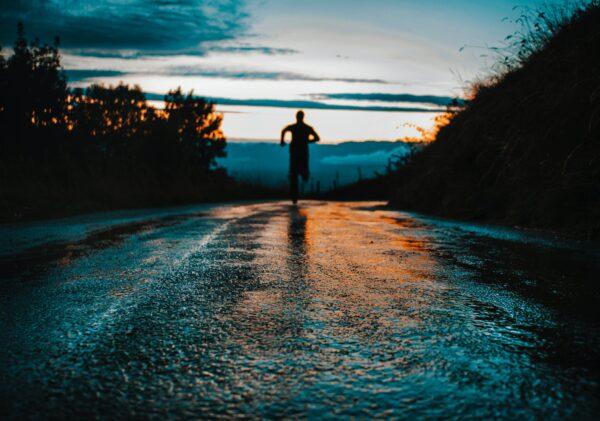 Man running into sunset